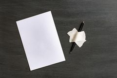 White paper sheet and pen glued to the surface with adhesive tape royalty free stock images
