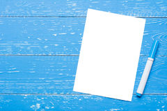 White paper sheet with space for text and blue marker Stock Images