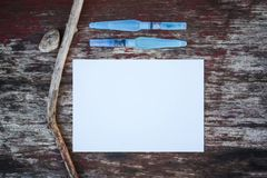 White paper and water brushes on wooden background. White paper sheet and water brushes on wooden background royalty free stock image