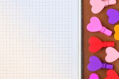 White paper and small colored hearts. Note to the Valentine`s Da stock image