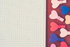 White paper and small colored hearts. Note to the Valentine`s Da royalty free stock images