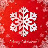 White paper snowflake on red ornate background Stock Photo