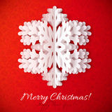 White paper snowflake on red ornate background. White paper vector snowflake on red ornate background Stock Photo