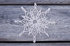 White paper snowflake. On wooden background. Handmade decoration for New Year and Christmas celebration Royalty Free Stock Photos