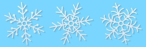 White paper snowflakes on a blue background. Happy New Year and Merry Christmas. Holiday elements. Set of snowflakes. Vector illus. Tration. EPS 10 vector illustration