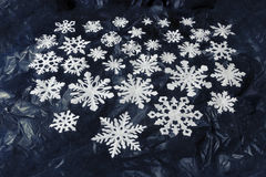 White paper snowflakes on dark blue background Royalty Free Stock Photography