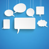 White Paper Speech Bubbles Blue. Paper speech bubbles on the blue background Royalty Free Stock Photos