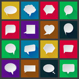 White paper speech bubbles on colorful background in flat design with long shadows Royalty Free Stock Image