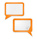 White paper speech bubbles on orange background Royalty Free Stock Images