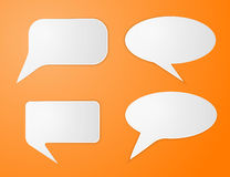 White paper speech bubbles on orange background Royalty Free Stock Photo