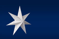 White paper star on blue Stock Photo