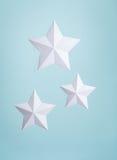 White Paper Stars. Three handmade White paper stars hanging as decoration stock images