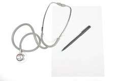 White paper, stethoscope and a pen Royalty Free Stock Photos