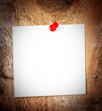 White paper sticky note reminder With red Push Pin on wooden old. White Paper sheet  reminder With red Push Pin on wooden old background Royalty Free Stock Photos