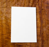 White paper on table. White paper pad on antique or aged wooden table stock photography
