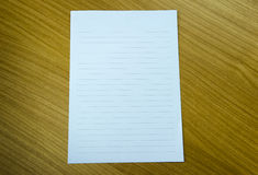 White paper on table Stock Image