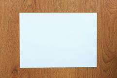 White paper on table wood Royalty Free Stock Photography