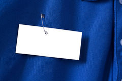 White Paper Tag or Label on Blue Shirt Royalty Free Stock Images