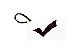 White paper tag labeled with checkmark symbol Stock Photo