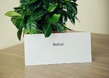 White paper with text NOTICE in the office. Copy space stock images