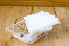 White paper tissue  in a white  boxes made of wire on a wood tab Royalty Free Stock Photos