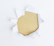 White paper torn outside brown paper Royalty Free Stock Photo