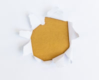 White paper torn outside brown paper Royalty Free Stock Photography