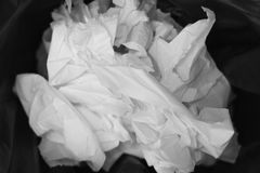 White paper and trash tissue dirty in toilet .  bin storage in restroom . royalty free stock photo