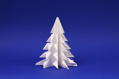 White paper tree on blue background Origami tree Stock Images