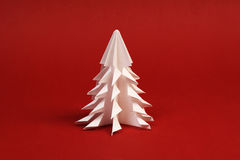 White paper tree on red background Royalty Free Stock Photo