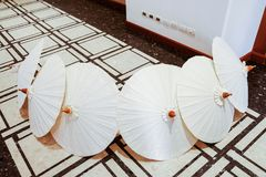 White paper umbrella on ground stock images