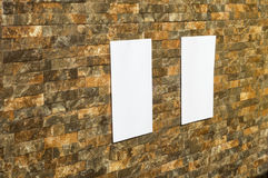 White paper in a wall. White paper in a rock wall, in sunshine, ideal for poster mock up Royalty Free Stock Photography