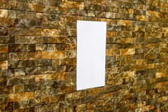 White paper in a wall. White paper in a rock wall, in sunshine, ideal for poster mock up Stock Images