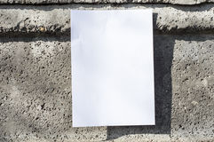 White paper on wall. In sunshine, ideal for poster mock up Stock Images