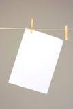 White paper on washing line Royalty Free Stock Photos