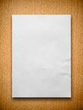 White paper on wood. White blank paper on beech wood background Stock Photography