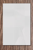 White paper on wood. Isolated white paper on wood royalty free stock photography