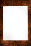 White paper on wood background. White paper on a wood table Royalty Free Stock Image