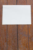 White paper on wood Royalty Free Stock Image