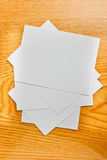 White paper on wood table Royalty Free Stock Photo