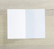 White Paper On Wood Table Of Background. White Paper On Wood Table Of The Background royalty free stock images