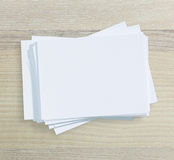 White Paper On Wood Table Of Background. White Paper On Wood Table Of The Background Stock Images