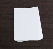White Paper On Wood Table Of Background. White Paper On Wood Table Of The Background Royalty Free Stock Photography