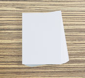 White Paper On Wood Table Of Background. White Paper On Wood Table Of The Background stock photo