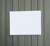 White Paper On Wood Table Of Background. White Paper On Wood Table Of The Background stock photography