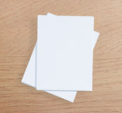 White Paper On Wood Table Of Background. White Paper On Wood Table Of The Background Royalty Free Stock Photo
