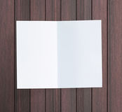 White Paper On Wood Table Of Background. White Paper On Wood Table Of The Background Stock Photos