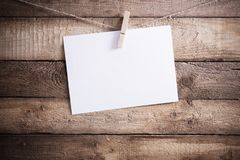 White paper on wooden background Stock Image