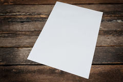 White paper on wooden background. stock photography