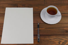 White paper on a wooden table Stock Photography